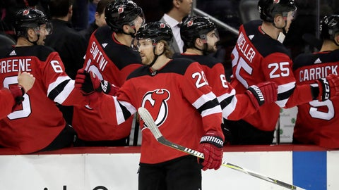 <p>               New Jersey Devils center Blake Coleman (20) swings by the bench after scoring a goal on the Buffalo Sabres during the first period of an NHL hockey game, Monday, March 25, 2019, in Newark, N.J. (AP Photo/Julio Cortez)             </p>