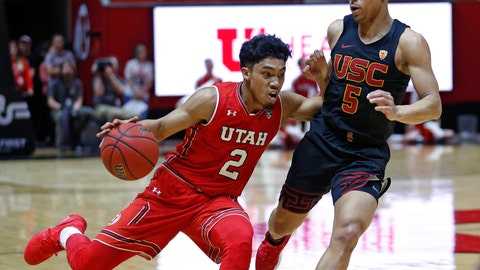 <p>               Utah guard Sedrick Barefield (2) drives around Southern California guard Derryck Thornton (5) during the second half of an NCAA college basketball game Thursday, March 7, 2019, in Salt Lake City. (AP Photo/Rick Bowmer)             </p>