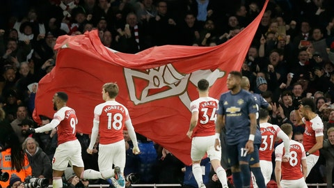 <p>               Arsenal players celebrate after Arsenal's Pierre-Emerick Aubameyang scored his side's second goal during the English Premier League soccer match between Arsenal and Manchester United at the Emirates Stadium in London, Sunday, March 10, 2019. (AP Photo/Tim Ireland)             </p>