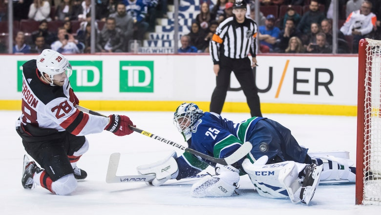 Devils rally from 2 goals down, beat Canucks 3-2 in shootout