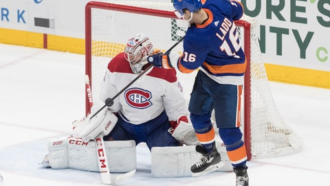 <p>               Montreal Canadiens goaltender Carey Price (31) makes a save against New York Islanders left wing Andrew Ladd (16) during the third period of an NHL hockey game, Thursday, March 14, 2019, in Uniondale, N.Y. (AP Photo/Mary Altaffer)             </p>
