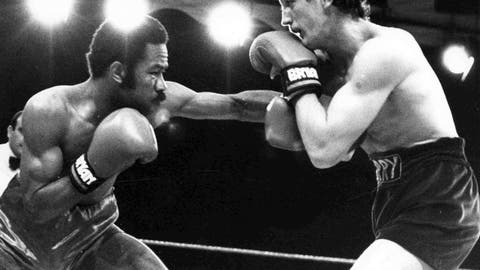 <p>               FILE - In this June 9, 1985 file photo, defending champion Eusebio Pedroza from Panama, left, throws a punch at Northern Ireland's Barry McGuigan, during their World Featherweight Championship fight at Queen's Park Rangers Football Ground, London. The Panamanian ex-featherweight champ died on Friday, March 1, 2019. He was 62.   (AP Photo/Bob Dear, File)             </p>