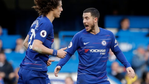 <p>               Chelsea's Eden Hazard, right, celebrates with Chelsea's David Luiz after scoring his side's opening goal during the English Premier League soccer match between Chelsea and Wolverhampton Wanderers at Stamford Bridge stadium in London, Sunday, March 10, 2019. (AP Photo/Matt Dunham)             </p>
