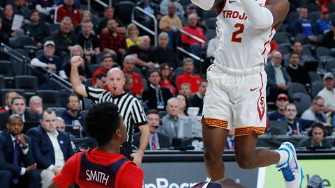 <p>               Southern California's Jonah Mathews (2) drives into Arizona's Dylan Smith while shooting in the first half of an NCAA college basketball game in the first round of the Pac-12 conference tournament Wednesday, March 13, 2019, in Las Vegas. (AP Photo/John Locher)             </p>