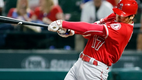 <p>               FILE - In this Sept. 5, 2018, file photo, Los Angeles Angels' Shohei Ohtani follows through on a two-run home run against the Texas Rangers during the eighth inning of a baseball game in Arlington, Texas. Ohtani got a modest raise from the Angels after winning the AL Rookie of the Year award, agreeing to a one-year contract that boosts his pay to $650,000 from last year's minimum of $545,000. (AP Photo/Ray Carlin, File)             </p>
