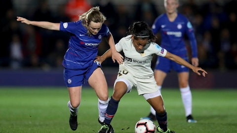 <p>               Chelsea Women's Erin Cuthbert, left, in action with Paris Saint-Germain Women's Perle Morroni during their Women's Champions League quarter final first leg match at the Cherry Red Records Stadium in London, Thursday March 21, 2019. (Bradley Collyer/PA via AP)             </p>