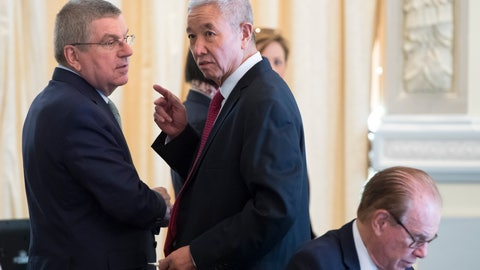 <p>               International Olympic Committee (IOC) president Thomas Bach, left, from Germany, speaks with International Olympic Committee (IOC) Vice-President Zaiqing Yu, right, from China at the opening of the first day of the executive board meeting of the International Olympic Committee (IOC), in Lausanne, Switzerland, Tuesday, March 26, 2019. (Laurent Gillieron/Keystone via AP)             </p>