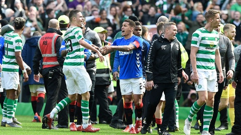 <p>               Celtic's Mikael Lustig with his shirt torn remonstrates with Rangers James Tavernier, during their Scottish Premiership soccer match at Celtic Park in Glasgow, Scotland, Sunday March 31, 2019. (Ian Rutherford/PA via AP)             </p>