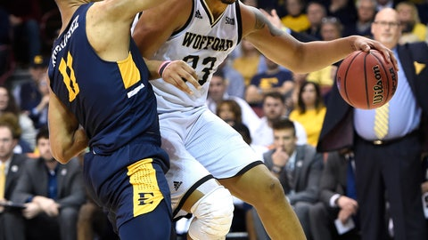 <p>               Wofford forward Cameron Jackson (33) tries to move the ball around East Tennessee State forward Jeromy Rodriguez (11) in the first half of a semifinal NCAA college basketball game for the Southern Conference tournament championship, Sunday, March 10, 2019, in Asheville, N.C. (AP Photo/Kathy Kmonicek)             </p>