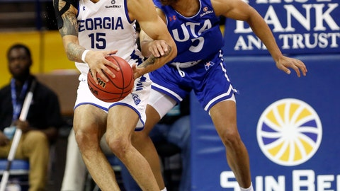 <p>               Georgia State guard D'Marcus Simonds (23) is defended by Texas-Arlington guard Edric Dennis (5) during the first half of the NCAA college basketball championship game of the Sun Belt Conference men's tournament in in New Orleans, Sunday, March 17, 2019. (AP Photo/Tyler Kaufman)             </p>