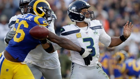 <p>               File-This Nv. 11, 2018, file photo shows Los Angeles Rams defensive end Dante Fowler forcing a fumble by Seattle Seahawks quarterback Russell Wilson during the second half in an NFL football game in Los Angeles.  Fowler has re-signed with the Los Angeles Rams, passing up a shot at unrestricted free agency to stay with the NFC champions. The Rams announced a deal Sunday, March 10, 2019, to keep Fowler, but didn't disclose the terms. (AP Photo/Alex Gallardo, File)             </p>