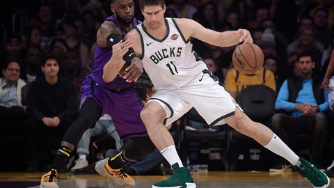 <p>               Los Angeles Lakers forward LeBron James, left, reaches in on Milwaukee Bucks center Brook Lopez during the first half of an NBA basketball game Friday, March 1, 2019, in Los Angeles. (AP Photo/Mark J. Terrill)             </p>