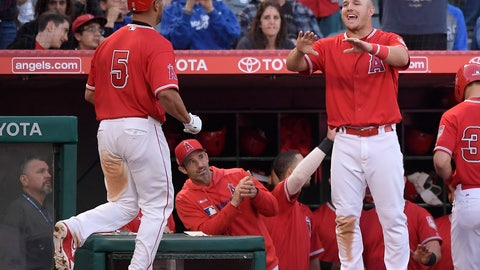<p>               Los Angeles Angels' Albert Pujols, left, is congratulated by Mike Trout, right, as manager Brad Ausmus watches during the fourth inning of the team's preseason baseball game against the Los Angeles Dodgers on Sunday, March 24, 2019, in Anaheim, Calif. (AP Photo/Mark J. Terrill)             </p>