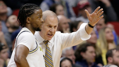 <p>               Michigan coach John Beilein, right, talks to Zavier Simpson, left,during the first half of a first round men's college basketball game against Montana in the NCAA Tournament in Des Moines, Iowa, Thursday, March 21, 2019. (AP Photo/Nati Harnik)             </p>
