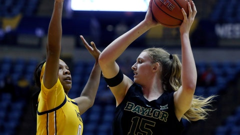 <p>               Baylor forward Lauren Cox (15) looks to make a pass while defended by West Virginia guard Naomi Davenport (0) during the first half of an NCAA college basketball game Monday, March 4, 2019, in Morgantown, W.Va. (AP Photo/Raymond Thompson)             </p>