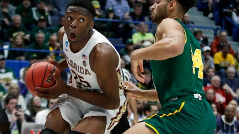 <p>               Florida State's Mfiondu Kabengele (25) looks for room to drive against Vermont's Isaiah Moll (14) during the first half of a first round men's college basketball game in the NCAA Tournament, Thursday, March 21, 2019, in Hartford, Conn. (AP Photo/Elise Amendola)             </p>