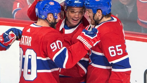 <p>               Montreal Canadiens center Max Domi (13) celebrates with teammates Tomas Tatar (90) and Andrew Shaw (65) after scoring against the Detroit Red Wings during the second period of an NHL hockey game Tuesday, March 12, 2019, in Montreal. (Ryan Remiorz/The Canadian Press via AP)             </p>