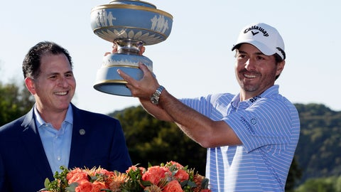 <p>               Kevin Kisner, right, holds his trophy presented by Michael Dell, CEO of Dell Technologies, after he defeated Matt Kuchar in the finals at the Dell Technologies Match Play Championship golf tournament, Sunday, March 31, 2019, in Austin, Texas. (AP Photo/Eric Gay)             </p>