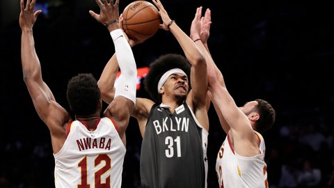 <p>               Cleveland Cavaliers guard David Nwaba (12) and forward Larry Nance Jr. (22) defend against Brooklyn Nets center Jarrett Allen (31) during the first half of an NBA basketball game Wednesday, March 6, 2019, in New York. (AP Photo/Kathy Willens)             </p>