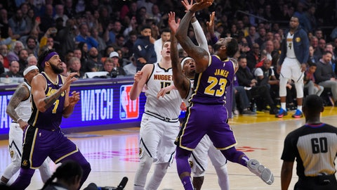 <p>               Los Angeles Lakers forward LeBron James (23) shoots and scores as Denver Nuggets forward Torrey Craig, second from right, defends and center Nikola Jokic, center, watches along with Lakers center JaVale McGee, left, during the first half of an NBA basketball game Wednesday, March 6, 2019, in Los Angeles. With that basket, James moved past Michael Jordan for fourth place on the NBA career scoring list. (AP Photo/Mark J. Terrill)             </p>
