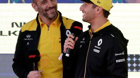 <p>               Renault driver Daniel Ricciardo of Australia, right, talks as team principal Cyril Abiteboul listens during the launch for the Australian Grand Prix in Melbourne, Australia, Wednesday, March 13, 2019. (AP Photo/Rick Rycroft)             </p>