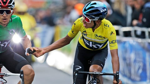 <p>               Colombia's Egan Arley Bernal Gomez, wearing the overall leader's yellow jersey, thanks teammate Poland's Michal Kwiatkowski, wearing the best sprinter's green jersey, as they cross the finish line of the eighth stage of the Paris Nice cycling race with start and finish in Nice, southeastern France, Sunday, March 17, 2019. (AP Photo/Claude Paris)             </p>