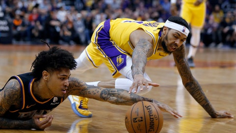 <p>               Phoenix Suns forward Kelly Oubre Jr., left, dives for a loose ball in front of Los Angeles Lakers forward Brandon Ingram during the first half of an NBA basketball game Saturday, March 2, 2019, in Phoenix. (AP Photo/Rick Scuteri)             </p>