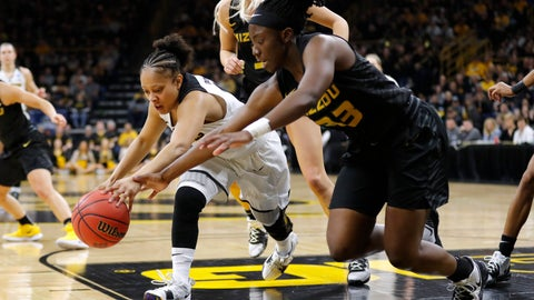 <p>               Iowa guard Tania Davis, left, fights for a loose ball with Missouri guard Amber Smith during a second round women's college basketball game in the NCAA Tournament, Sunday, March 24, 2019, in Iowa City, Iowa. (AP Photo/Charlie Neibergall)             </p>