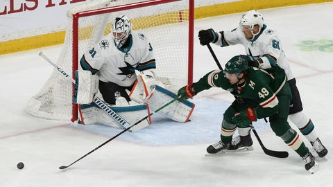 <p>               Minnesota Wild's Victor Rask, right, of Sweden, tries to reach the puck as San Jose Sharks' Justin Braun defends in the first period of an NHL hockey game Monday, March 11, 2019, in St. Paul, Minn. Watching is goalie Martin Jones, left. (AP Photo/Jim Mone)             </p>