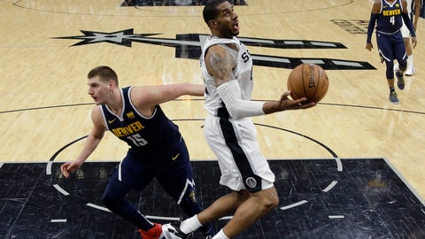 <p>               San Antonio Spurs center LaMarcus Aldridge, right, drives to the basket past Denver Nuggets center Nikola Jokic (15) during the second half of an NBA basketball game, in San Antonio, Monday, March 4, 2019. (AP Photo/Eric Gay)             </p>