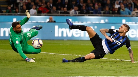 <p>               FILE - In this Sunday, Oct. 21, 2018 file photo, Inter Milan's Mauro Icardi, right, tries to score over AC Milan goalkeeper Gianluigi Donnarumma during the Serie A soccer match between Inter Milan and AC Milan at the San Siro Stadium, in Milan, Italy. Just five months after beating AC Milan a derby defeat could leave crisis-hit Inter Milan in danger of missing out on the Champions League. Icardi scored a stoppage-time winner in the October derby but he has not played in more than a month, since being stripped off his captaincy amid protracted contract negotiations. Icardi's downfall and Krzysztof Piatek's arrival at Milan from Genoa means the two sides approach the second derby of the season in very different moods to the first. (AP Photo/Antonio Calanni, File)             </p>