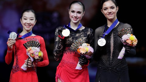<p>               From left, Japan's Rika Kihira, Russia's Alina Zagitova and Russia's Evgenia Medvedeva display their silver, gold and bronze medals respectively for the ladies free skating during the ISU World Figure Skating Championships at Saitama Super Arena in Saitama, north of Tokyo, Friday, March 22, 2019. (AP Photo/Andy Wong)             </p>