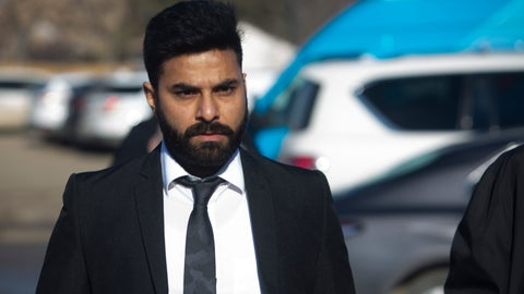 <p>               Jaskirat Singh Sidhu arrives for his sentencing hearing in Melfort, Saskatchewan., Friday, March, 22, 2019.  Sidhu, of Calgary, the driver of a transport truck involved in a bus crash that killed 16 people with the Humboldt Broncos junior hockey team in Canada last year, pleaded guilty earlier this year to 29 counts of dangerous driving. (Kayle Neis/The Canadian Press via AP)             </p>