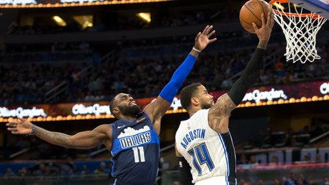 <p>               Orlando Magic guard D.J. Augustin (14) lays the ball up next to Dallas Mavericks guard Tim Hardaway Jr. (11) during the first half of an NBA basketball game in Orlando, Fla., Friday, March 8, 2019. (AP Photo/Willie J. Allen Jr.)             </p>