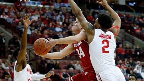 <p>               Wisconsin guard Brad Davison, center, goes up to shoot between Ohio State forward Andre Wesson, left, and guard Musa Jallow during the first half of an NCAA college basketball game in Columbus, Ohio, Sunday, March 10, 2019. (AP Photo/Paul Vernon)             </p>