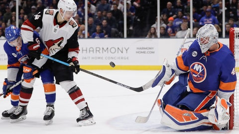 <p>               Arizona Coyotes' Richard Panik (14) watches as New York Islanders goaltender Robin Lehner (40) stops a shot on the goal as Ryan Pulock (6) defends him during the third period of an NHL hockey game Sunday, March 24, 2019, in Uniondale, N.Y. The Islanders won 2-0. (AP Photo/Frank Franklin II)             </p>
