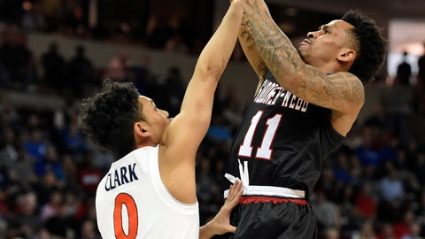 <p>               Gardner-Webb's David Efianayi (11) shoots over Virginia's Kihei Clark (0) during a first-round game in the NCAA men's college basketball tournament in Columbia, S.C., Friday, March 22, 2019. (AP Photo/Richard Shiro)             </p>