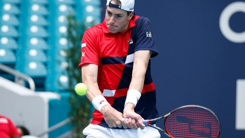 <p>               John Isner returns a volley to Albert Ramos-Vinglas, of Spain, during the Miami Open tennis tournament, Sunday, March 24, 2019, in Miami Gardens, Fla. (AP Photo/Joel Auerbach)             </p>