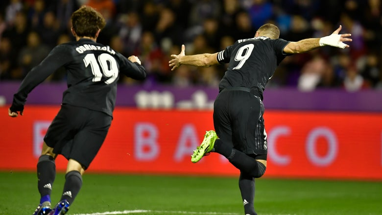 Late goal gives 10-man Valencia win over Girona