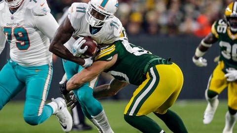 <p>               FILE - In this Nov. 11, 2018, file photo, Miami Dolphins' DeVante Parker (11) is brought down during an NFL football game against the Green Bay Packers in Green Bay, Wis. Parker has signed an incentive-laden, two-year deal worth up to $13 million that replaces a $9.4 million fifth-year option on his original contract. (AP Photo/Jeffrey Phelps, File)             </p>