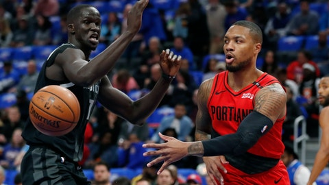 <p>               Portland Trail Blazers guard Damian Lillard, right, passes as Detroit Pistons forward Thon Maker, left, defends during the first half of an NBA basketball game, Saturday, March 30, 2019, in Detroit. (AP Photo/Carlos Osorio)             </p>