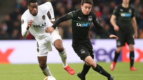 <p>               Valencia's Geoffrey Kondogbia, left, and Krasnodar's Mauricio Pereyra challenge for the ball during the Europa League round of 16, second leg soccer match between FC Krasnodar and Valencia at the Krasnodar Stadium in Krasnodar, Russia, Thursday, March 14, 2019. (AP Photo/Vitaliy Timkiv)             </p>