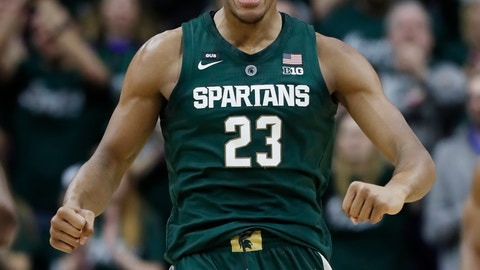 <p>               Michigan State forward Xavier Tillman reacts after a basket during the first half of an NCAA college basketball game against Nebraska, Tuesday, March 5, 2019, in East Lansing, Mich. (AP Photo/Carlos Osorio)             </p>