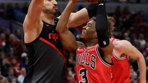 <p>               Chicago Bulls guard Shaquille Harrison, right, drives to the basket as Portland Trail Blazers center Enes Kanter defends during the first half of an NBA basketball game Wednesday, March 27, 2019, in Chicago. (AP Photo/Nam Y. Huh)             </p>
