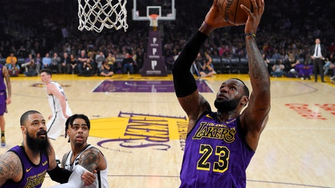 <p>               Los Angeles Lakers forward LeBron James, right, shoots as center Tyson Chandler, left, and Brooklyn Nets guard D'Angelo Russell watch during the first half of an NBA basketball game Friday, March 22, 2019, in Los Angeles. (AP Photo/Mark J. Terrill)             </p>
