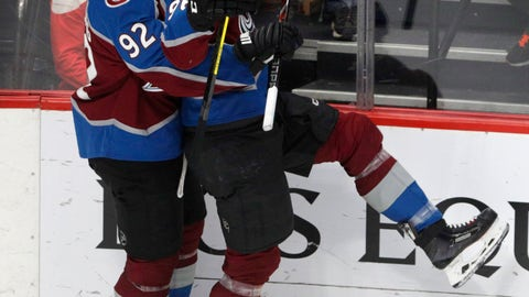 <p>               Colorado Avalanche left wing Gabriel Landeskog (92) hugs right wing Mikko Rantanen (96) after Rantanen's goal against the Detroit Red Wings during the third period of an NHL hockey game in Denver, Tuesday, March 5, 2019. Colorado won 4-3 in overtime. (AP Photo/Joe Mahoney)             </p>