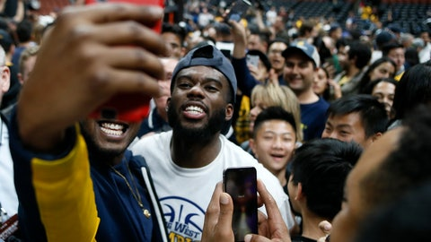 <p>               UC Irvine guard Max Hazzard, center, takes a selfie with a fan after an NCAA college basketball game against Cal State Fullerton for the Big West men's tournament championship in Anaheim, Calif., Saturday, March 16, 2019. UC Irvine won 92-64. (AP Photo/Alex Gallardo)             </p>