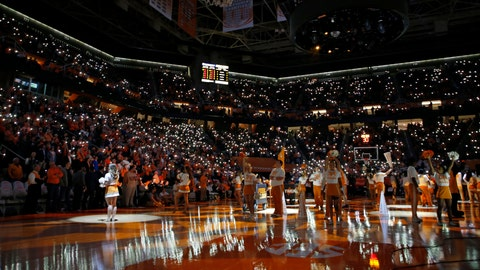 <p>               FILE - In this Feb. 19, 2019 file photo, fans hold up their cell phones with the flashlight on as music plays before an NCAA college basketball game between Tennessee and Vanderbilt in Knoxville, Tenn.  College basketball teams are trying to get fans to keep coming to games in the age of smartphones by making those phones an integral part of the experience. That's evident every time cellphones in the stands light up arenas across the country during pregame lineup introductions. (AP photo/Wade Payne, File)             </p>
