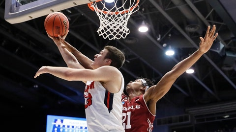 <p>               Belmont's Nick Muszynski (33) shoots against Temple's Justyn Hamilton (21) during the first half of a First Four game of the NCAA college basketball tournament, Tuesday, March 19, 2019, in Dayton, Ohio. (AP Photo/John Minchillo)             </p>