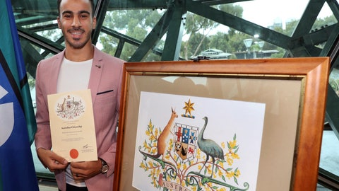 <p>               Hakeem al-Araiby, a former Bahraini international soccer player and refugee displays his certificate after becoming an Australian citizen, four weeks after escaping extradition to his homeland during a much-publicized detention in a Thai prison, in Melbourne, Tuesday, March 12, 2019. Al-Araiby, who fled Bahrain citing political repression, had lived under refugee status in Australia for more than a year until detained in Bangkok in November while on holiday. (David Crosling/AAP Image via AP)             </p>